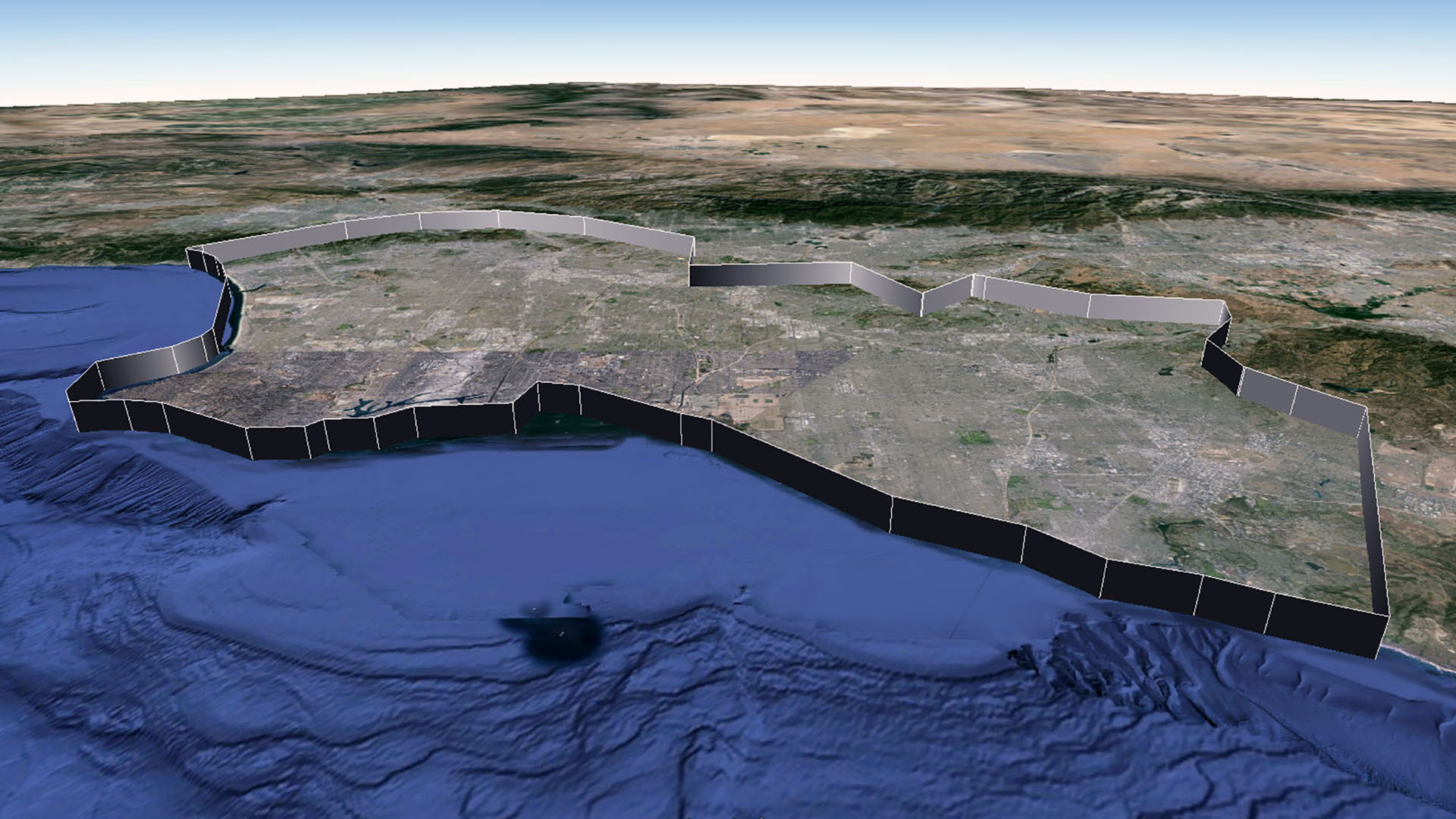 The Frontier of Resolution, here visualized as a wall about 1,500 meters in height, straddles the border between Los Angeles and Orange Counties in Southern California. Judging from Google's initial promotional material release, Los Angeles was among the first four cities to be digitally modeled using the stereophotogrammetry process. As such, the frontier is brazen in its divisions, and can be described with a spartan 49 placemarks (compare to the later completed model of Chicago, which requires 419 placemarks to trace its edge).